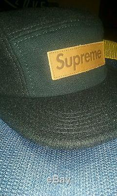 Supreme lodge camp cap black leather box logo woolrich feathers cdg